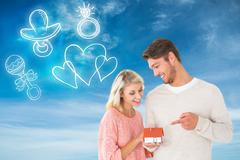 Composite image of attractive couple holding miniature house model Stock Illustration