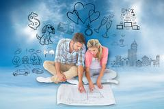 Composite image of attractive young couple sitting looking at blueprint Stock Illustration