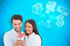 Composite image of attractive young couple holding a model house - stock illustration