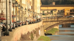 Lungarno walk with streetlights in a row and Old Bridge in the background Stock Footage
