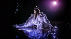 Night angel in water - stock footage