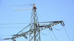 Man climbing down electrical power line 4k Stock Footage