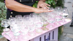 Hands playing glass cups close up Stock Footage