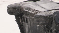 Car crash in snow storm car rolled over in winter storm Stock Footage