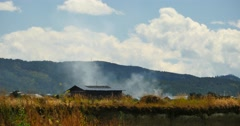 4k burn smoke & tibetan-houses,clouds over mountains in Shangri-La yunnan. Stock Footage