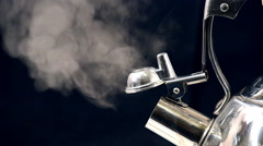 Steaming tea kettle Close up. Black background. Stock Footage