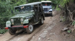 A jeep is passing through an unpaved road. Stock Footage