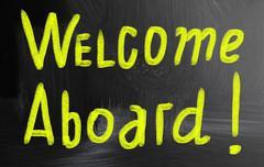 Welcome aboard handwritten with chalk on a blackboard Stock Photos