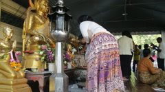 Buddhist shrine people pay respect Stock Footage