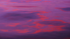 The tranquil water of the peaceful late with beautiful reflection of rosy sky. Stock Footage