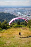 Paraglider running for take off Stock Photos