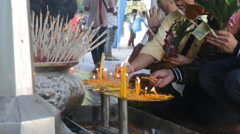 Buddhist temple candles people Stock Footage