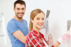 Smiling couple doing renovations at home Stock Photos