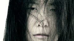 Scary closeup of ugly bad asian woman Stock Footage