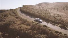 Aerial Flight following classic car through the country side Stock Footage