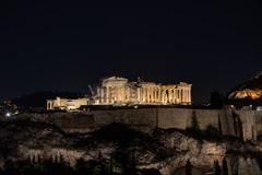 The Parthenon illuminated at night Stock Photos