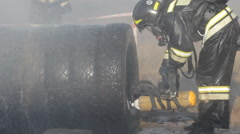 Firefighters in helmets and uniforms at exercises outdoors Stock Footage