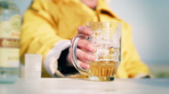 Man taking a beer mug in slow motion. Stock Footage