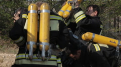 Firefighters wear masks and balloons - stock footage