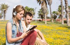 Couple listening to music - stock photo