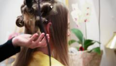 Hairstylist using a curling iron. Stock Footage