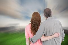 Stock Photo of Composite image of casual couple standing arm around