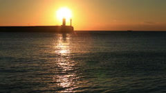 Beacon in Yalta at sunrise, a view from the central city embankment, the Crimea Stock Footage