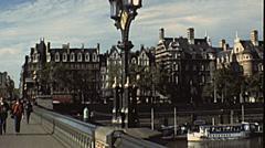 London 1979: people walking over Westminster bridge - stock footage