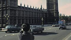 London 1979: traffic in front of the House of Parliament - stock footage