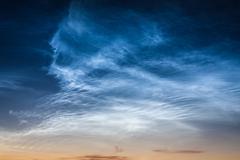 Beautiful sky phenomenon noctilucent clouds Stock Photos