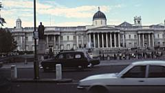 London 1979: traffic in front of Trafalgar square Stock Footage