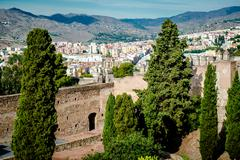 Stock Photo of gibralfaro fortress (alcazaba de malaga) and view of malaga city. spain