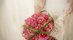 Bride holding a  beautiful bridal bouquet at a wedding. - stock footage