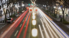Night time lapse of busy street in Omotesando Tokyo Japan trademarks obscured Stock Footage