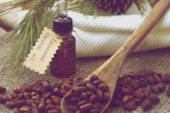 A dropper bottle of cedarwood essential oil Stock Photos
