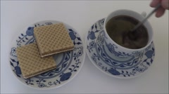 Cup of coffee with biscuits Stock Footage