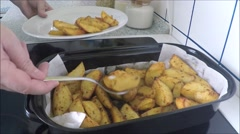 Baked potatoes on the pan Stock Footage
