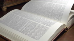 Turning a page of an antique book 4K Stock Footage