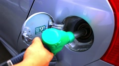 Pumping fuel in to the Car filling up with petrol. HD. 1920x1080 Stock Footage