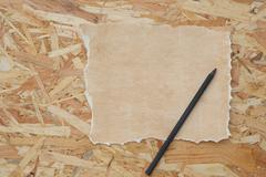 A distressed sheet of paper and a pen - stock photo