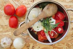 Prepared food ingredients for cooking Italian tomato sauce - salsa. Ingredien - stock photo