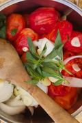 Prepared food ingredients for cooking Italian tomato sauce - salsa- in the po - stock photo