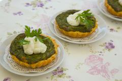 Homemade mini spinach and ricotta tart - stock photo