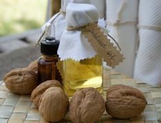 Bottle of walnut oil - stock photo