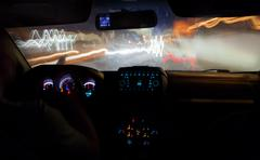 Speed driving in the city at night - stock photo