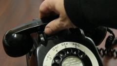 Rotary dial UK telephone pick up handset - stock footage