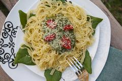 Tagliatelle with spinach, tomatoes and cheese Stock Photos
