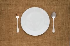 Empty white plate spoon and fork Stock Photos