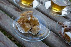 Light dessert -turkish delight with sesame seeds on the plate Stock Photos