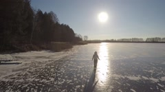 Sunny day on the ice river Stock Footage